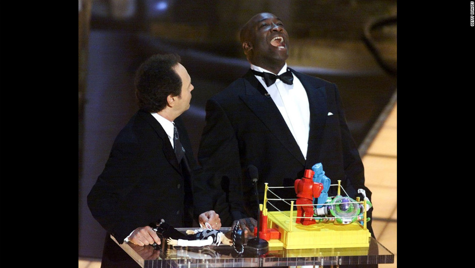 Academy Awards host Billy Crystal and Duncan present the animated action short film award during the ceremony in 2000.
