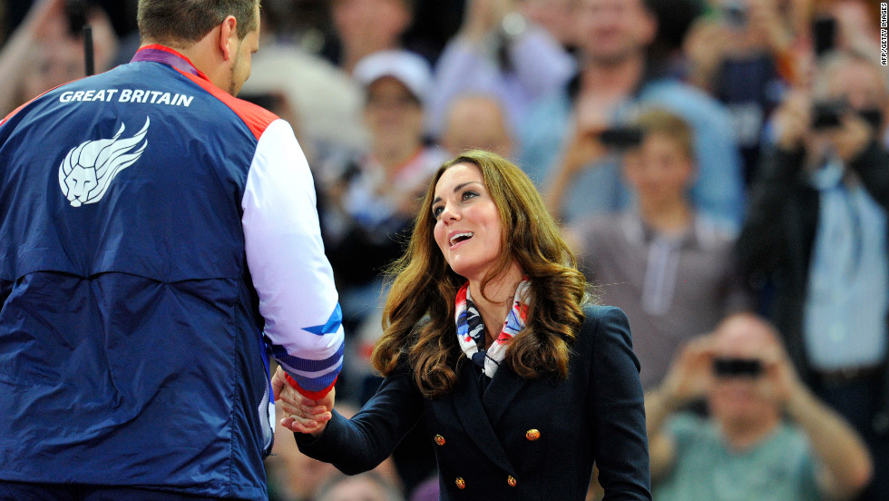Catherine, Duchess of Cambridge, presents the gold medal to Aled Davies of Great Britain after he won the men's discus F42 athletics event.