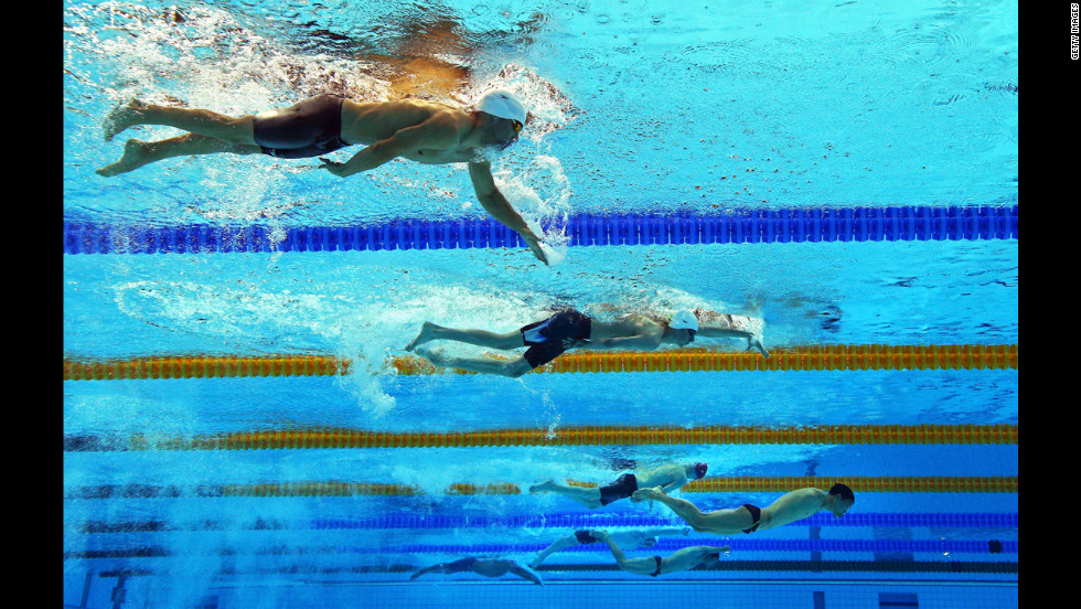 Swimmers compete in the men's 200-meter individual medley SM6 heat 2 at the Aquatics Center.