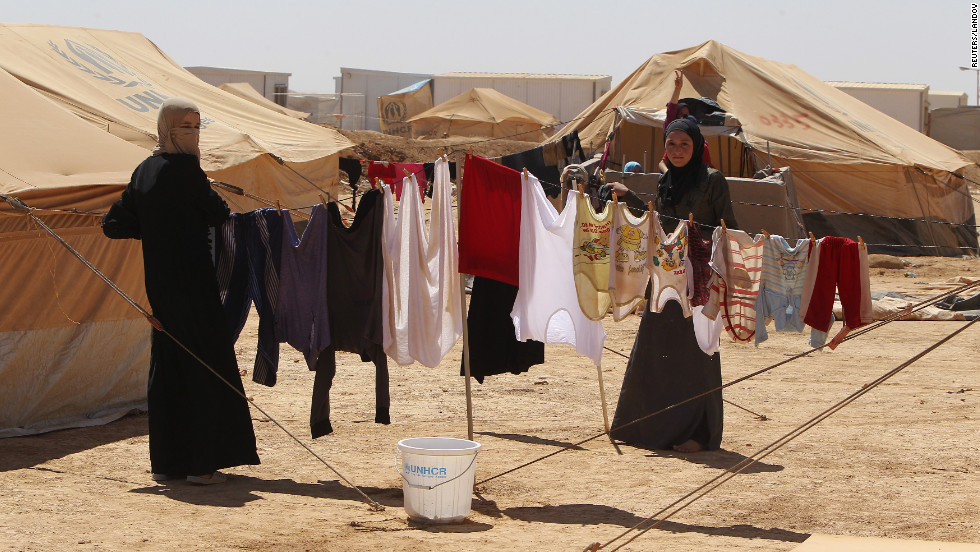 Clothes hang to dry after being washed.