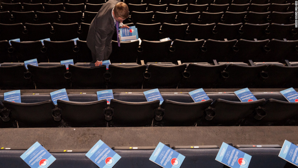 Brian Romanowski distributes delegate information packages inside the arena on Tuesday.