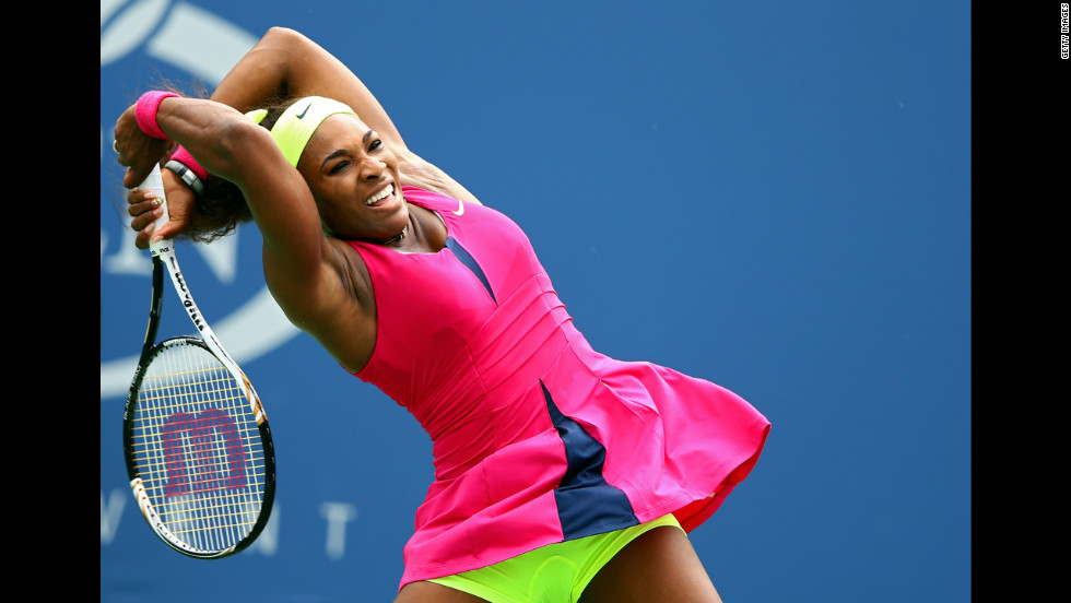 American Serena Williams returns a shot Monday.