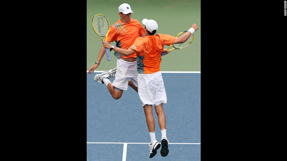 Mike Bryan, right, and Bob Bryan of the United States bump chests in celebration during their doubles match against Santiago Gonzalez of Mexico and Scott Lipsky of the United States on Monday.