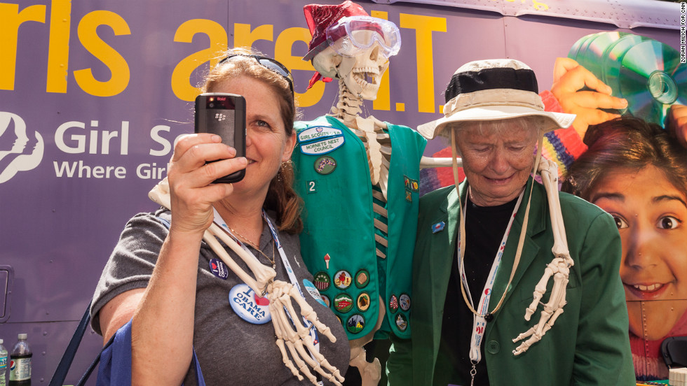 Sara Riley takes a picture Monday while she and her mother, Nan Riley, pose with a Girl Scouts skeleton.