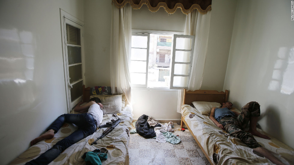 Free Syrian Army fighters sleep in a room in Aleppo on Wednesday.
