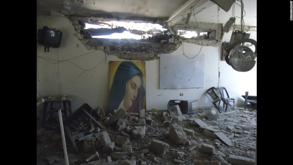 Im Al-Zinar church shows damage Tuesday in the western city of Homs.
