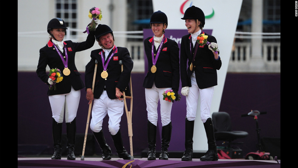 Sophie Wells, Lee Pearson, Deborah Criddle and Sophie Christiansen of Great Britain wear their team gold medals for the equestrian event on Tuesday.