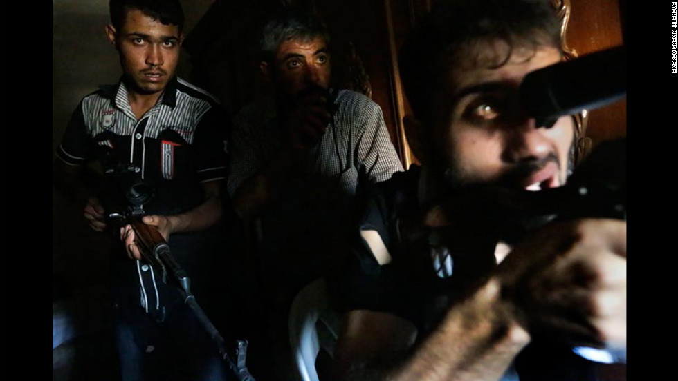 "A sniper opens fire while a plane bombs the area. The battle to take the Aleppo police station lasted more than five hours on Sunday, August 26, photographer Ricardo Garcia Vilanova said. See more in the exclusive video, ""<a href=""http://www.cnn.com/video/?hpt=hp_t3#/video/world/2012/09/06/walsh-syria-old-city.cnn"" target=""_blank"">Rebels battle for 100 feet in Aleppo</a>."""