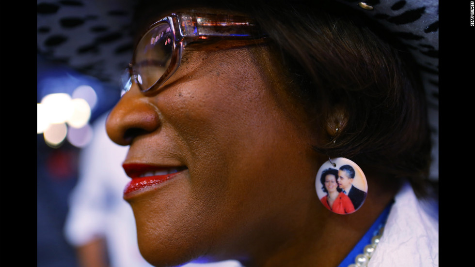 Delegate Gloria Goodwin wears earrings depicting President Barack Obama and first lady Michelle Obama on Wednesday.