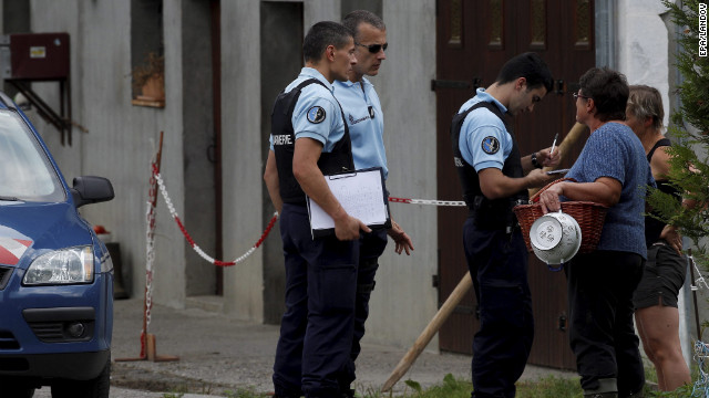 Image #: 19263589    epa03384952 French Police officers talks with neighbors of the road leading the scene where four people died in a shooting at a parking in Chevaline near the Annecy Lake, France, 05 September 2012. The bodies of four people who had been shot dead were found in the French Alps, prosecutors said late 05 September, while a young girl survived the attack and was in a critical condition.  The bodies of a man and two women were found by a cyclist in a British-registered car in a secluded car park near Lake Annecy. The girl and the body of a male cyclist were found nearby. All had gun shot wounds.  EPA/NORBERT FALCO /LANDOV