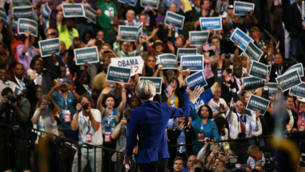 "U.S. Senate candidate Elizabeth Warren of Massachusetts waves to the crowd Wednesday. A consumer advocate, she complained that people today ""feel like the system is rigged against them."""