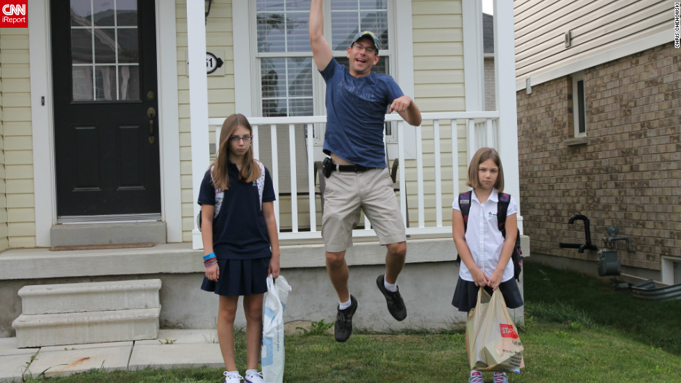"In Binbrook, Ontario, Canada, Madison and Emma were nervous about their first day of school so dad Chris Chehowski mustered up enthusiasm for everyone. ""At the end of the day, I picked up my daughters and it turned out that they were anxious for no reason! Both came home excited about their class, their teacher and what they did that day -- They had worked themselves up for nothing!"""