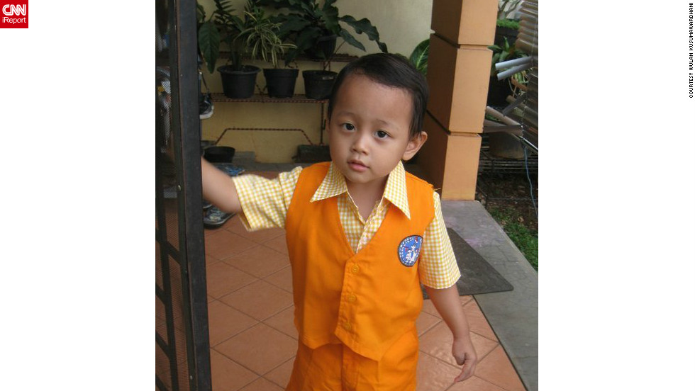 "Mario's mom was proud to see him in his uniform and ready for the first day of kindergarten in Tangerang, Indonesia. ""He was in a bit bad mood at first because I think he was still sleepy, but by the time he arrived at school, he was happy to see his friends."""