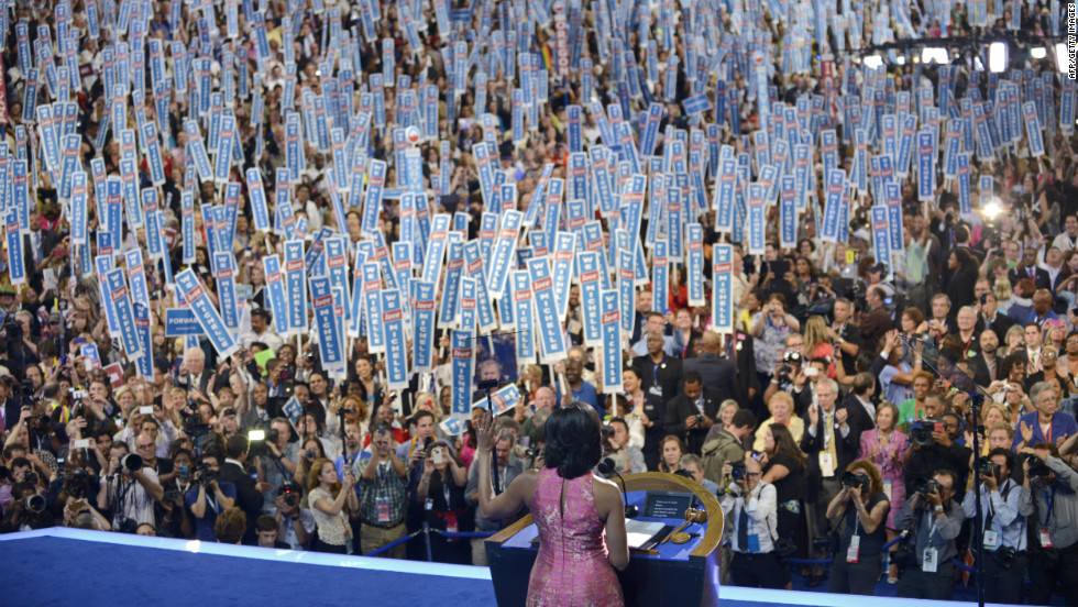 First lady Michelle Obama waves to the audience on Tuesday.