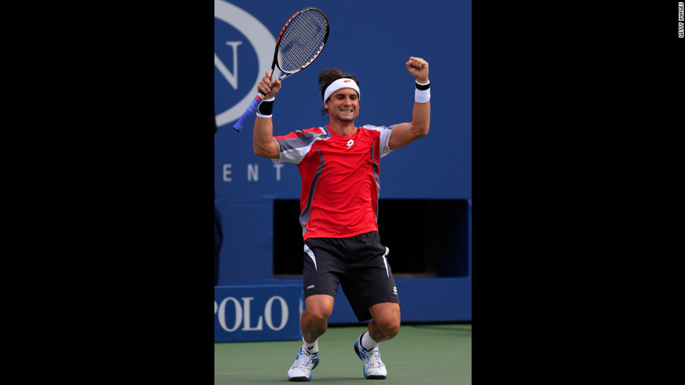 Spain's David Ferrer celebrates his men's singles quarterfinal victory over Serbia's Janko Tipsarevic on Thursday.