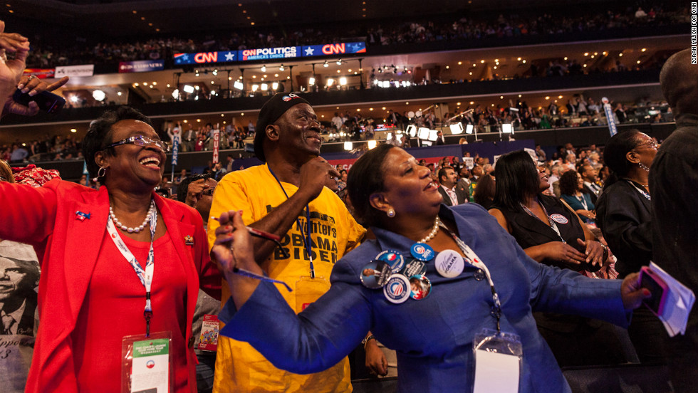 Delegates show their excitement on the floor of the convention on Thursday.