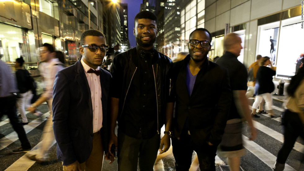 Darnell Barclift, 22, Jamel Pearson, 23, and Jason Campbell, 25, pose in front of traffic.