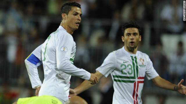 Cristiano Ronaldo scores Portugal's equalizer in Luxembourg watched by fellow striker Helder Postiga.