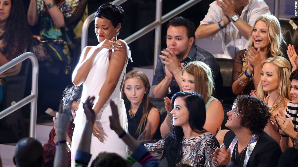 "Singer Rihanna stands to accept the award for video of the year for ""We Found Love."""