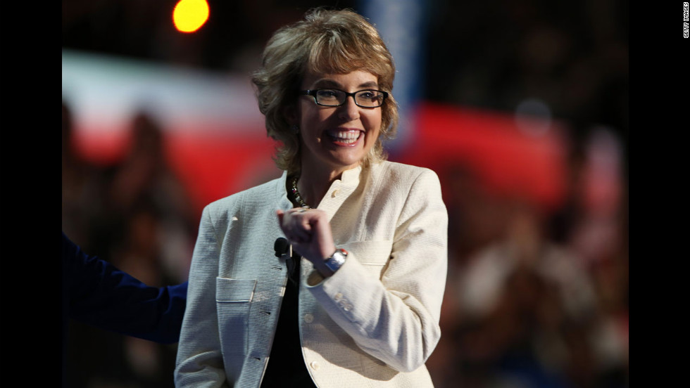 Former U.S. Rep. Gabrielle Giffords stands on stage during the final day of the Democratic National Convention.