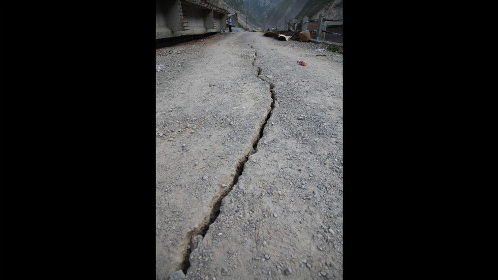 A crack from an earthquake winds through the ground in Luozehe Town in Yunnan province.