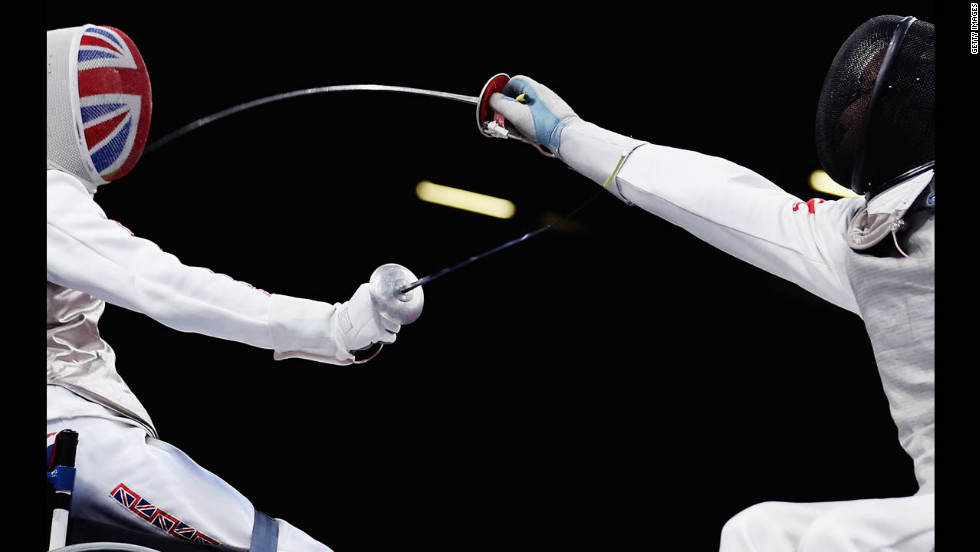 Simon Wilson, left, of Great Britain competes against Tang Tat Wong of Hong Kong during the men's open wheelchair fencing quarter-final match on Saturday.