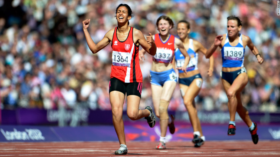 Neda Bahi of Tunisia crosses the line to win gold ahead of silver medalist Viktoriya Kravchenko of Ukraine, No. 1389, and bronze medalist Evgeniya Trushnikova of Russia, No. 1337, in the women's 400-meter T37 final on Saturday.