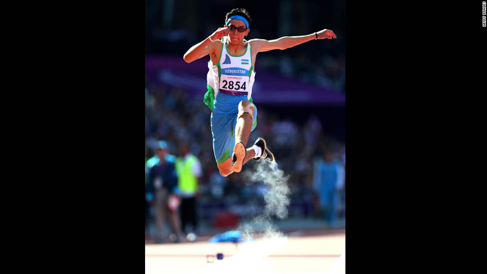 Doniyor Saliev of Uzbekistan competes in the men's triple jump F12 final on Saturday.