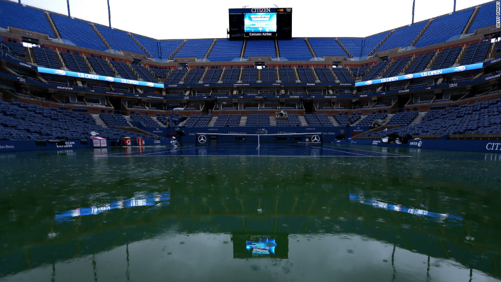 Rain falls on center court in Arthur Ashe stadium, causing officials to suspend play on day 13 of the 2012 U.S. Open on Saturday, September 8.