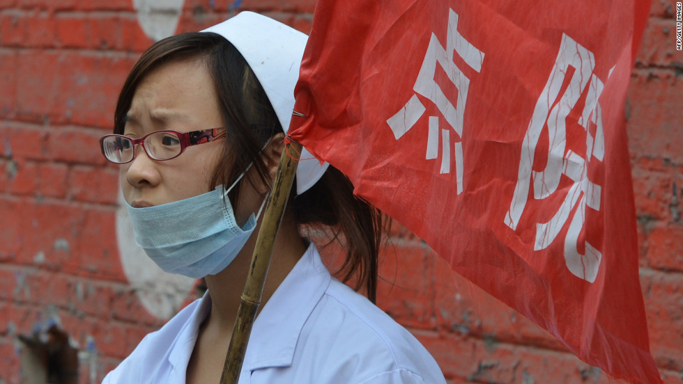 A nurse waits outside a first aid center on Saturday.