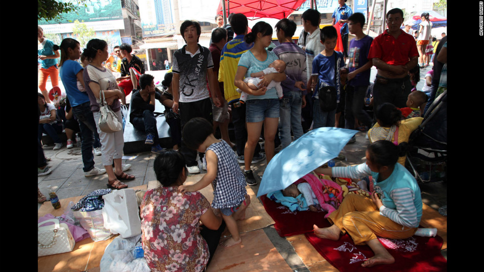 Survivors gather at a shelter on Saturday.