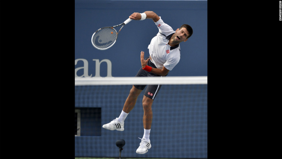 Djokovic comes down on the ball while playing Ferrer on Saturday.