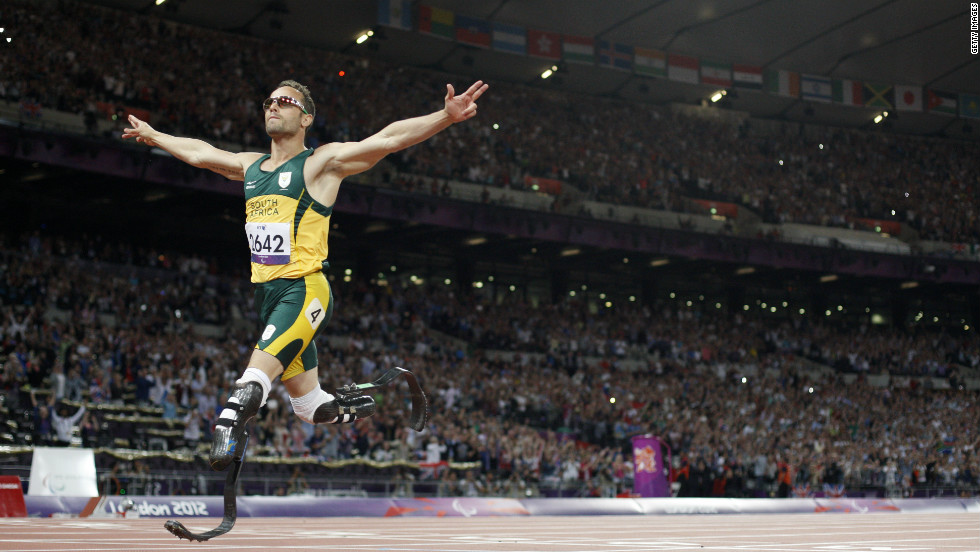 "South Africa's Oscar Pistorius, also known as the ""Blade Runner,"" crosses the line to win gold in the men's 400-meter T44 final. Pistorius also competed in the London Olympics."