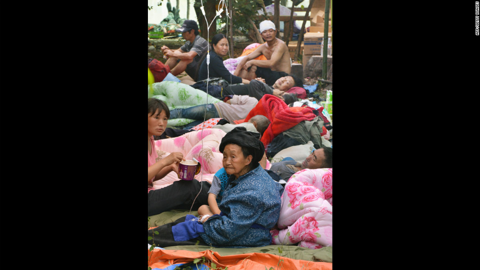 Injured villagers receive medical treatment at an evacuation center in Yiliang on Sunday.