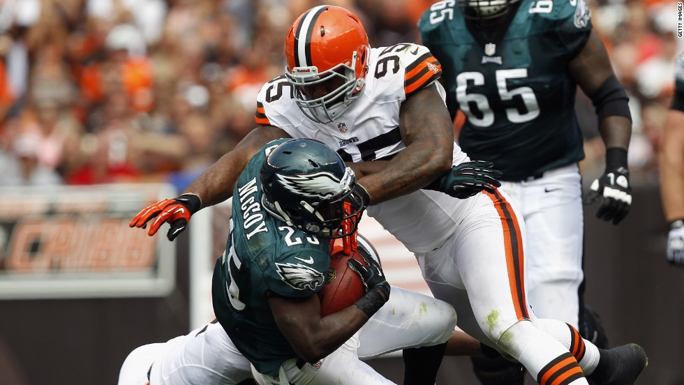 No.25 running back LeSean McCoy of the Philadelphia Eagles is hit by No. 95 defensive lineman Juqua Parker of the Cleveland Browns on Sunday.