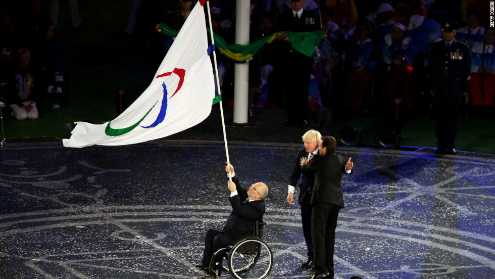 From left: Sir Philip Craven, president of the International Paralympic Committee; Boris Johnson, mayor of London; and Eduardo Paes, mayor of Rio de Janeiro,  perform the Paralympic flag handover ceremony.