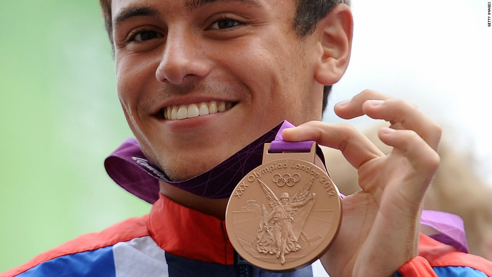 Daley shows off his Olympics bronze medal to the crowd.