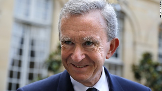 Bernard Arnault, France's richest man, says he will remain a tax resident of France despite a new 75% tax rate.