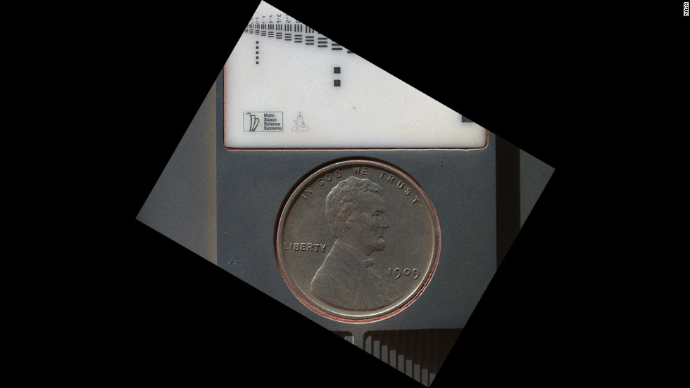 The penny in this image is part of a camera calibration target on NASA's Mars rover Curiosity. The image was taken by the Mars Hand Lens Imager camera.