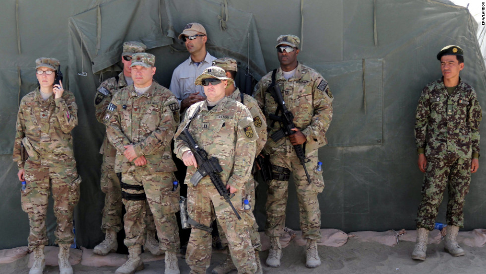 U.S. soldiers and an Afghan army soldier attend the ceremony handing over the Bagram prison to Afghan authorities on the outskirts of Kabul, Afghanistan, on Monday.