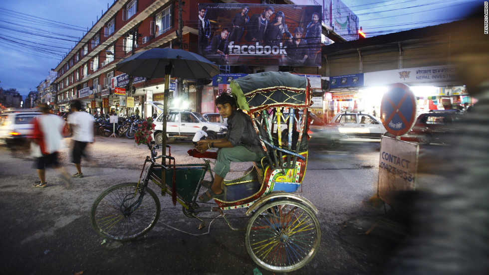 A rickshaw driver waits for passengers along the streets of Kathmandu on Monday.