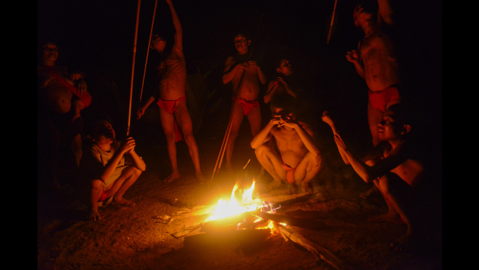 Yanomami natives gather around the fire.