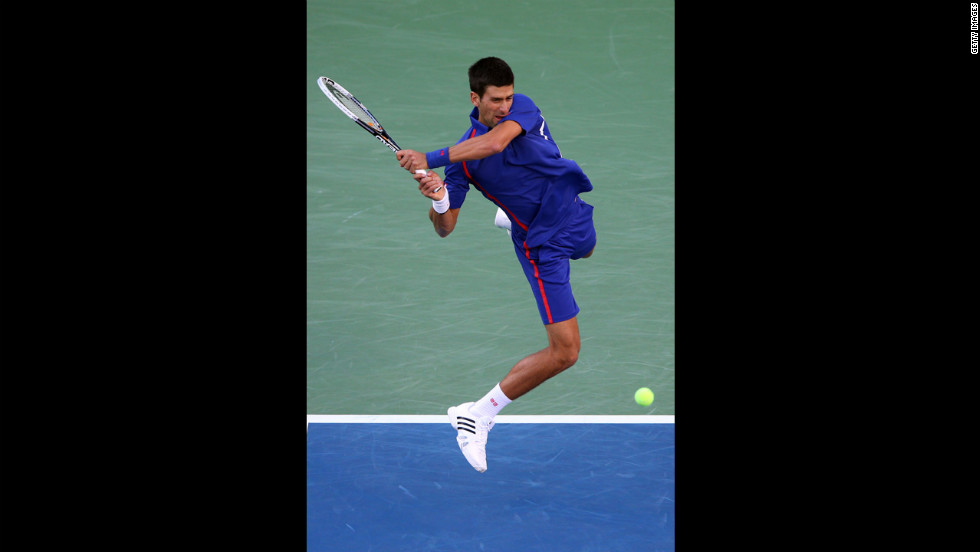 Novak Djokovic returns a shot to Andy Murray on Monday.