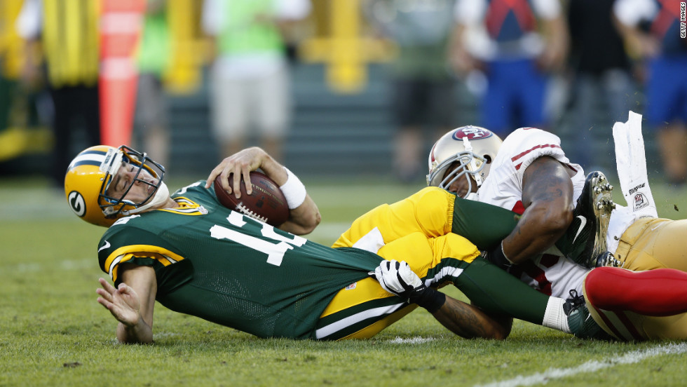 No. 55 Ahmad Brooks of the 49ers sacks No.12 Aaron Rodgers of the Packers on Sunday, September 9, in Wisconsin.
