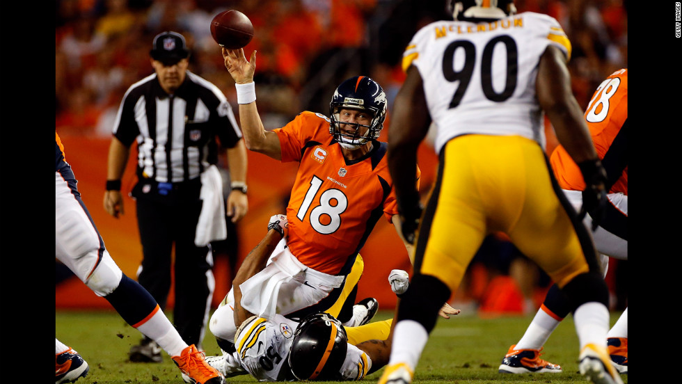 Manning attempts to get rid of the ball before being tackled by No. 50 linebacker Larry Foote of the Pittsburgh Steelers on Sunday.