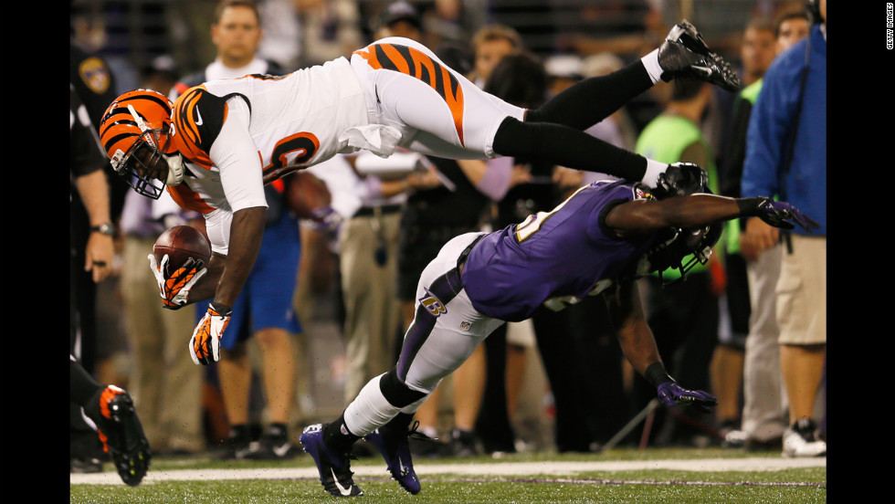 Wide receiver Armon Binns of the Cincinnati Bengals is tackled by cornerback Lardarius Webb of the Baltimore Ravens after catching a pass on Monday.