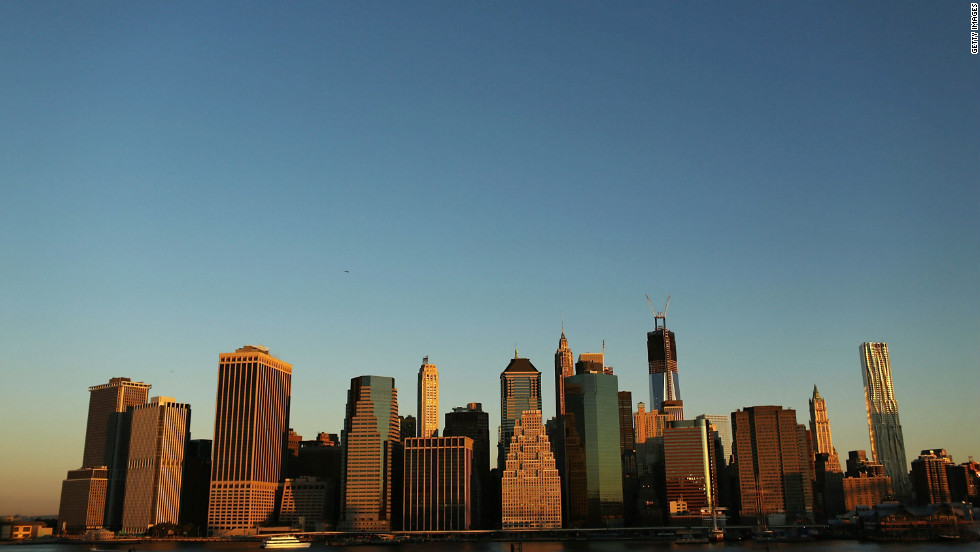 The skyline of Lower Manhattan now contains One World Trade Center, which is scheduled to be completed in 2013.