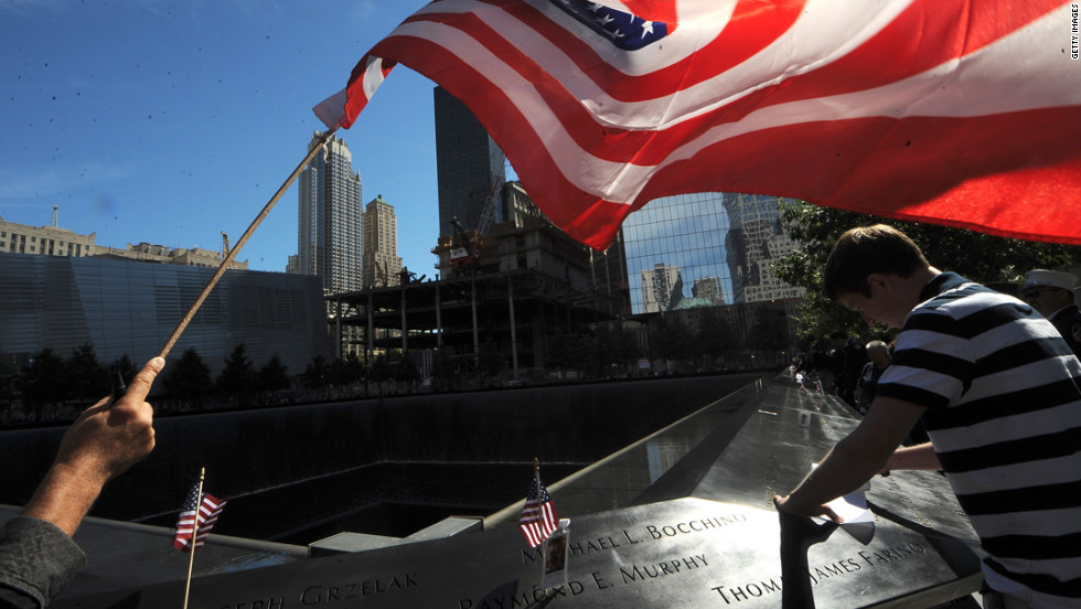 A flag is held over the reflection pool during remembrance ceremonies on Tuesday.