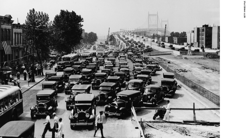 The Triborough Bridge linking Manhattan, Bronx and Queens opens in New York City on July 11, 1936. Pictured here are cars exiting the bridge in Harlem.