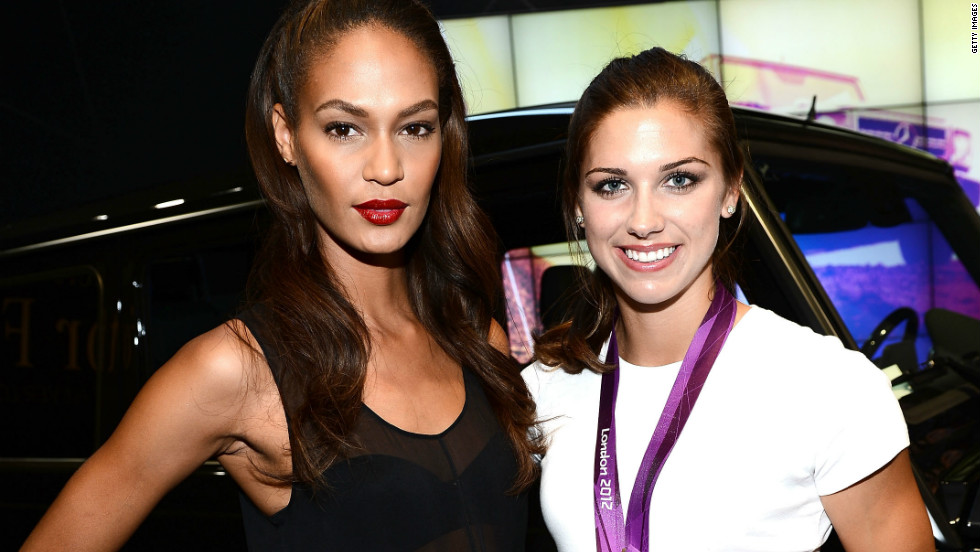 Puerto Rican model Joan Smalls and gold-medal soccer player Alex Morgan hang out in the New York Fashion Week tents.